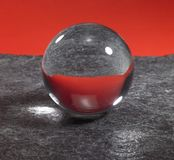 Crystal ball on stone surface Stock Images