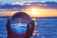 Crystal ball. The sun sets over Lake Constance in Germany and lit by a crystal ball Stock Images