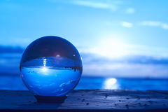 Crystal ball. The sun sets over Lake Constance in Germany and lit by a crystal ball Stock Photos