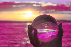 Crystal ball. The sun sets over Lake Constance in Germany and lit by a crystal ball Royalty Free Stock Photo