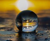 Crystal ball sunrise royalty free stock photography