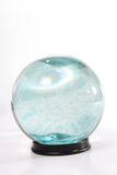 Crystal ball with swirling blu Stock Images