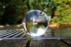 Crystal ball on a table Royalty Free Stock Photography