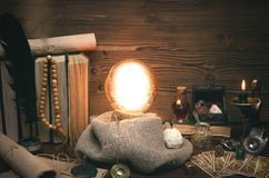 Crystal ball and tarot cards. Future reading. Fate divination. Crystal ball and tarot cards on fortune teller desk. Future reading concept. Paranormal magic stock photo