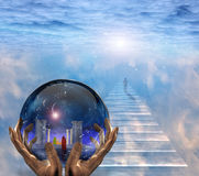 Crystal ball. With temple and monk inside. Figure of man walks to the light Stock Photo