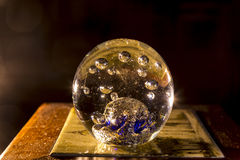 Crystal ball. View of an illuminated glass ball with a warm lamp Royalty Free Stock Photography