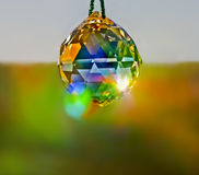 Crystal Ball in Window. Crystal in window captures brilliant colored reflections of sunlight royalty free stock photos