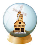 A crystal ball with a wooden house Stock Images