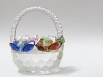 Glass precious stones basket Royalty Free Stock Photos