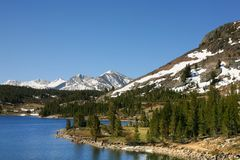 Crystal Blue Mountain Lake. Fishing in a clear mountain lake is pure relaxation Royalty Free Stock Photos