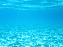Crystal blue underwater background. Or wallpaper stock photo