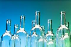 Crystal bottlenecks of empty glass bottles Stock Images