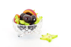 Crystal bowl with fruit. Crystal bowl with exotic fruit isolated on white Stock Image