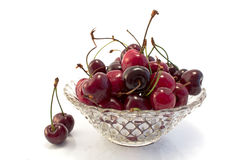 Crystal bowl full of cherries Royalty Free Stock Images