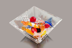Crystal bowl full of glass candy. Crystal bowl full of glass colorful candy Royalty Free Stock Photography