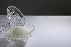 Crystal bowl with white sugar and lid Stock Images
