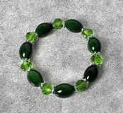 Crystal bracelet green color with silver accents on the abstract background Royalty Free Stock Image
