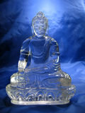 Crystal Buddha. Photo of artifact of buddha expertly carved by tibetian master into clear quartz crystal Royalty Free Stock Photo
