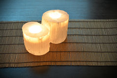 Crystal candle holders. Pair of crystal candle holders, candles are lit. Peaceful atmosphere Stock Photo