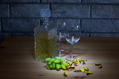 Crystal carafe of white wine, two glass, grapes on Stock Images