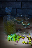 Crystal carafe of white wine, two glass, grapes on Royalty Free Stock Photo