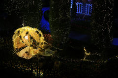 Crystal carriage gardening design. In the night garden crystal carriage flower bed in a golden light, like fairy tale scene is very fantastic Royalty Free Stock Photo