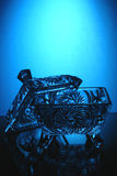 Crystal casket on a blue Royalty Free Stock Photography