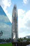 Crystal Cathedral. Puffy white clouds and bright blue sky reflected in the mirror surface of the Crystal Cathedral Stock Images