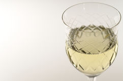 Crystal chalice with white wine Stock Photo
