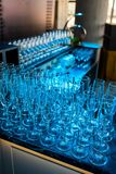 Crystal champagne and wine glasses at the event. With blue backlight royalty free stock images