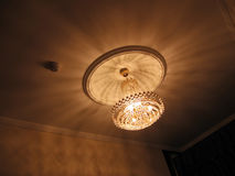 Crystal Chandelier. A crystal chandelier with a singular light stock image