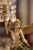 Crystal Chandelier and Angel Stock Images