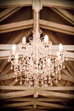 Crystal Chandelier. Beautiful crystal chandelier at an antique/vintage style wedding venue stock images