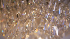 Crystal chandelier. Big classic crystals. Low angle shot of a big beautiful crystal luxury chandelier. stock video footage