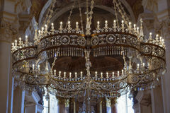 Crystal chandelier with candles in the Cathedral Of St. Nicholas Royalty Free Stock Photos