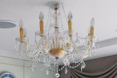 Crystal chandelier on ceiling Stock Photo