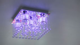 Crystal chandelier ceiling light turn on and off stock footage