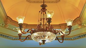 Crystal chandelier. Ceiling mounted victorian style crystal chandelier in a room royalty free stock photography