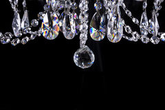 Crystal chandelier close-up on black. Crystal chandelier details on black background stock images