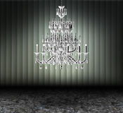 Crystal chandelier in a dark grungy room Stock Photos