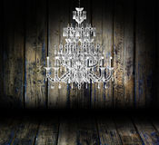 Crystal chandelier in a dark grungy room. Crystal chandelier hanging in a dark grungy room Royalty Free Stock Photos