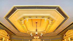 Crystal chandelier on decorated ceiling Royalty Free Stock Images