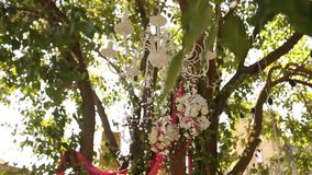 Crystal chandelier with flowers and garlands on wedding ceremony. Holiday decor, rustic style. stock footage