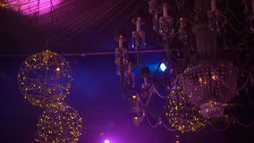 Crystal chandelier with golden garlands and soundlights 4K stock video