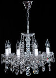 Crystal Chandelier. Group of hanging crystals. Image of grunge dark room interior with chandelier. Chrystal chandelier close-up. Luxury Glass Chandelier on Royalty Free Stock Photos
