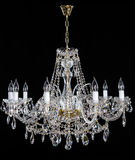 Crystal Chandelier. Group of hanging crystals. Image of grunge dark room interior with chandelier. Chrystal chandelier close-up. Luxury Glass Chandelier on Stock Photos
