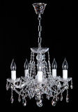Crystal Chandelier. Group of hanging crystals. Image of grunge dark room interior with chandelier. Chrystal chandelier close-up. Luxury Glass Chandelier on Royalty Free Stock Photography