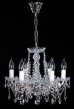 Crystal Chandelier. Group of hanging crystals. Image of grunge dark room interior with chandelier. Chrystal chandelier close-up. Luxury Glass Chandelier on Stock Images
