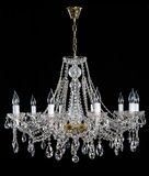 Crystal Chandelier. Group of hanging crystals. Image of grunge dark room interior with chandelier. Chrystal chandelier close-up. Luxury Glass Chandelier on Royalty Free Stock Photo