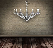 Crystal chandelier  in a grungy room Royalty Free Stock Photography
